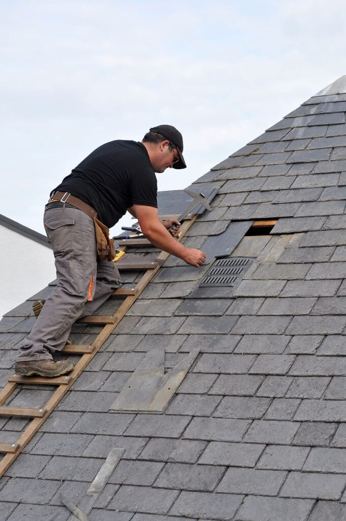 fixing a leaky shingle on the roof